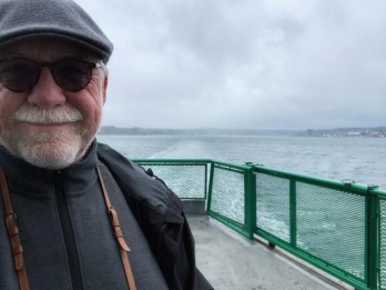 Dressed for the weather and on-board the Washington State Ferry. One of the best modes of transportation you can find.